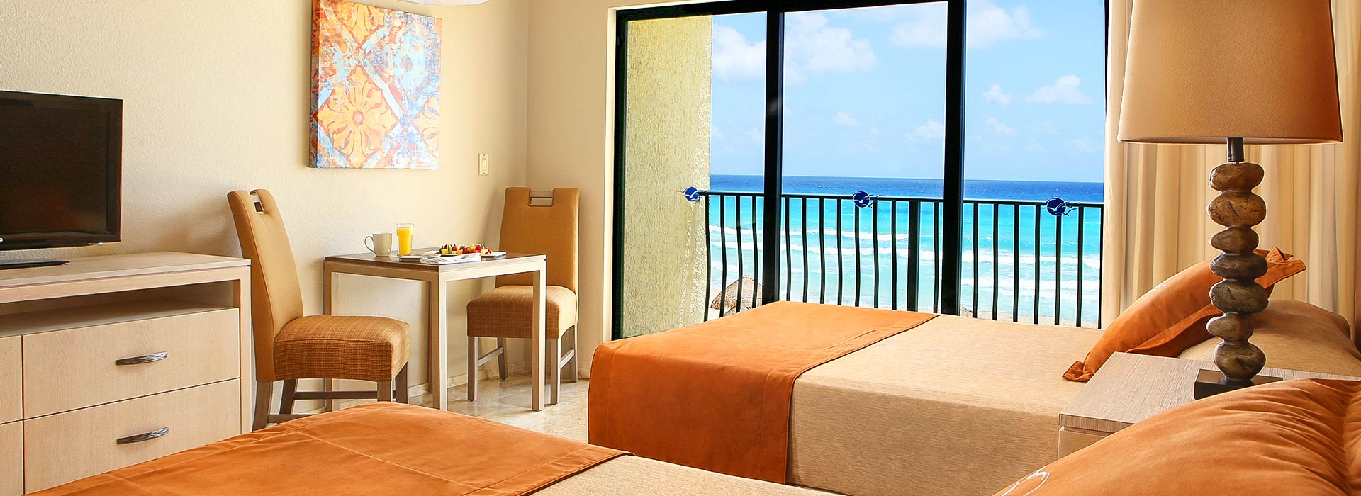 Beachfront Junior suite with double beds in Cancun beachfront resort