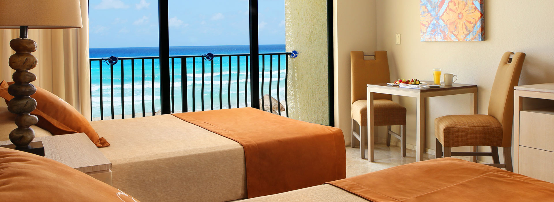 Ocean View Junior suite with ample seating area by the Mexican Caribbean Sea