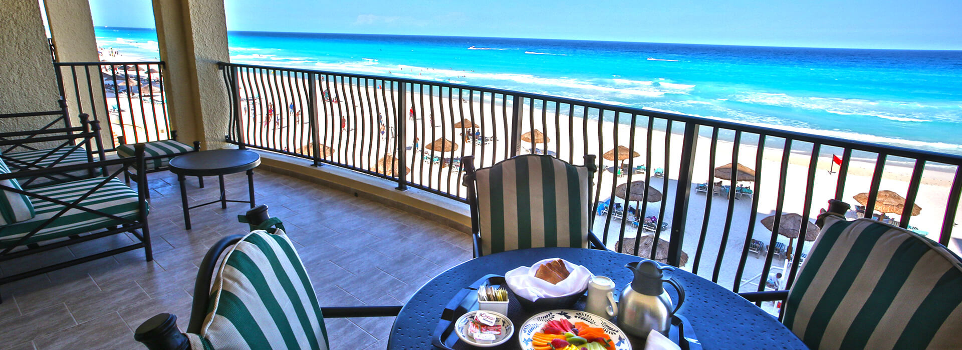 Private balcony with spectacular ocean views at your one bedroom beachfront suite