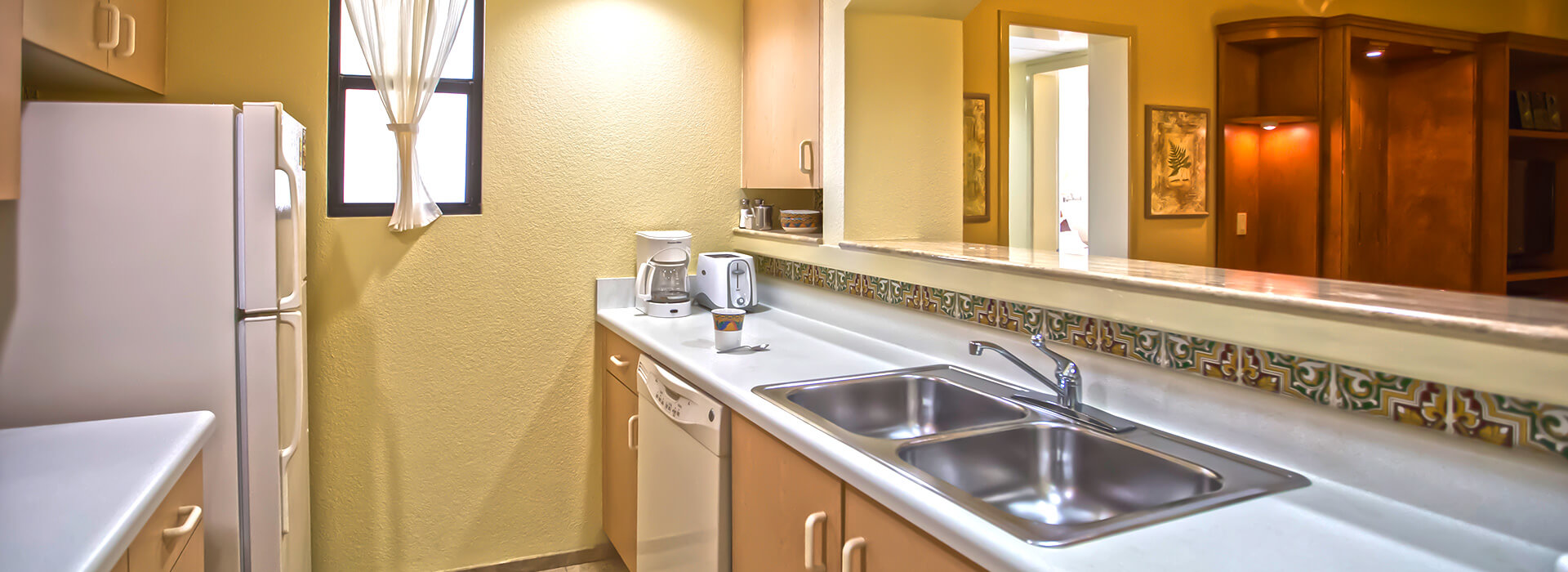 Beachfront villas with one bedroom suite and full kitchen during your Cancun All Inclusive vacations